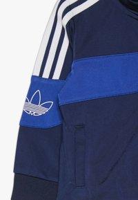 adidas Originals - BANDRIX - Chaqueta de entrenamiento - night indigo/royal blue/white - 4