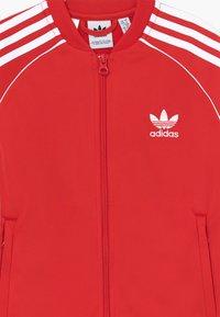adidas Originals - SUPERSTAR - Training jacket - lusred/white - 3