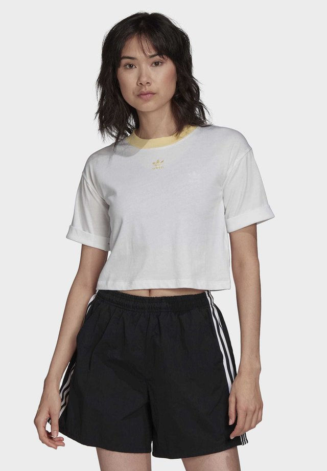 CROP TOP - T-shirt z nadrukiem - white