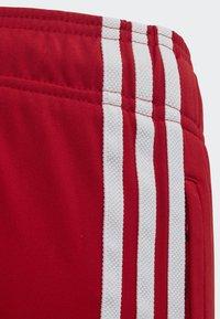 adidas Originals - SST TRACKSUIT BOTTOMS - Verryttelyhousut - red - 2