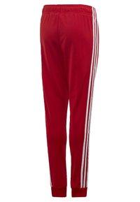 adidas Originals - SST TRACKSUIT BOTTOMS - Verryttelyhousut - red - 1