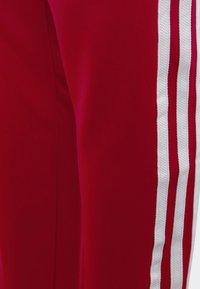 adidas Originals - SST TRACKSUIT BOTTOMS - Verryttelyhousut - red - 3