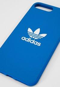 adidas Originals - Etui na telefon - bluebird/white - 2