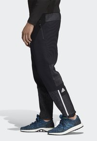 adidas Performance - ADIDAS Z.N.E. PRIMEKNIT PANTS - Trainingsbroek - black - 2