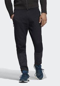 adidas Performance - ADIDAS Z.N.E. PRIMEKNIT PANTS - Trainingsbroek - black - 0