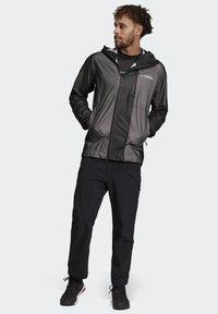 adidas Performance - TERREX PRIMEKNIT RAIN JACKET - Waterproof jacket - black - 1