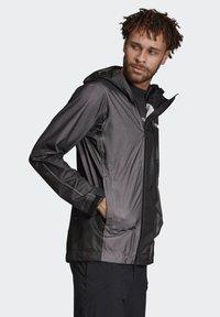 adidas Performance - TERREX PRIMEKNIT RAIN JACKET - Waterproof jacket - black - 4