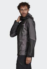 adidas Performance - TERREX PRIMEKNIT RAIN JACKET - Waterproof jacket - black - 3