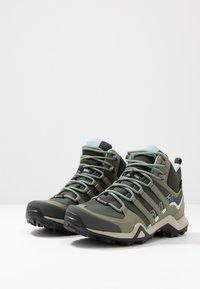 adidas Performance - TERREX SWIFT R2 MID GORE-TEX - Hiking shoes - legend erath/legend green/ash grey - 2