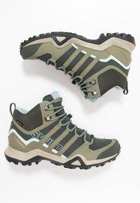 adidas Performance - TERREX SWIFT R2 MID GORE-TEX - Hiking shoes - legend erath/legend green/ash grey - 1