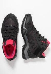 adidas Performance - TERREX AX3 MID GORE TEX - Zapatillas de senderismo - carbon/core black/active pink - 1