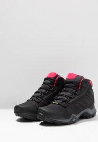 adidas Performance - TERREX AX3 MID GORE TEX - Zapatillas de senderismo - carbon/core black/active pink - 2