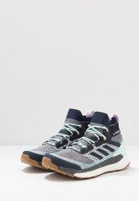 adidas Performance - TERREX FREE HIKER - Outdoorschoenen - light solid grey/legend ink/purple tint - 2
