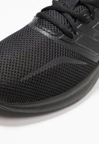 adidas Performance - RUNFALCON - Laufschuh Neutral - core black - 5