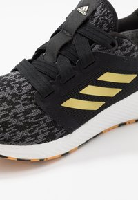 adidas Performance - EDGE LUX 3 - Neutral running shoes - core black/gold metallic/footwear white - 5