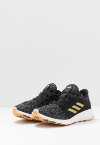 adidas Performance - EDGE LUX 3 - Neutral running shoes - core black/gold metallic/footwear white - 2