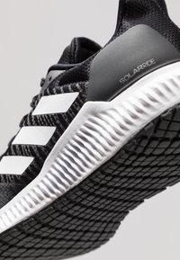 adidas Performance - SOLAR RIDE - Neutrala löparskor - core black/footwear white/grey five - 5
