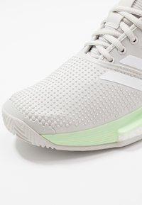 adidas Performance - SOLECOURT BOOST - Multicourt tennis shoes - glow green/footwear white/grey one - 5