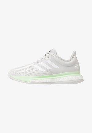 SOLECOURT BOOST - Multicourt tennis shoes - glow green/footwear white/grey one