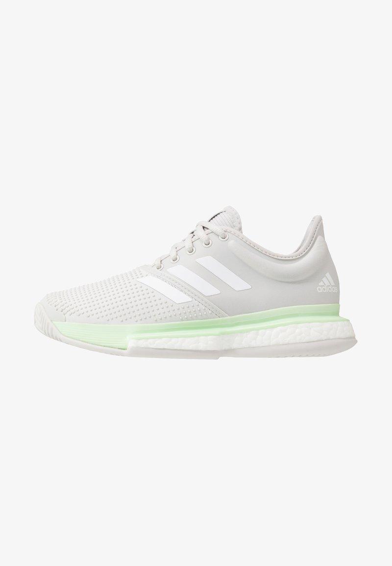 adidas Performance - SOLECOURT BOOST - Multicourt tennis shoes - glow green/footwear white/grey one