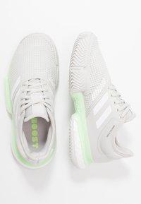 adidas Performance - SOLECOURT BOOST - Multicourt tennis shoes - glow green/footwear white/grey one - 1