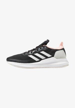 SOLAR BLAZE - Neutral running shoes - core black/grey one/glow pink