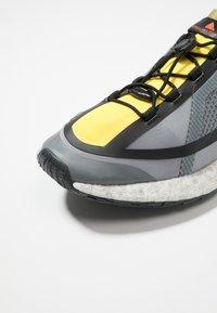 adidas by Stella McCartney - PUREBOOST HD SPORT RUNNING SHOES - Neutrální běžecké boty - iron metallic/vivid yellow/solar orange - 5