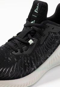 adidas Performance - ALPHABOUNCE PARLEY - Neutrální běžecké boty - core black/linen green/footwear white - 5