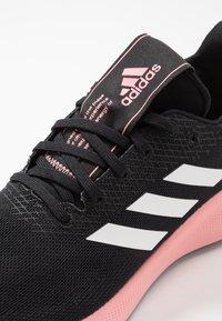 adidas Performance - SENSEBOUNCE + STREET - Neutral running shoes - core black/footwear white/glow pink - 5