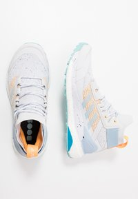 adidas Performance - TERREX FREE HIKER PARLEY - Hiking shoes - dash grey/easy blue/real gold - 1