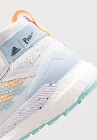 adidas Performance - TERREX FREE HIKER PARLEY - Hiking shoes - dash grey/easy blue/real gold - 6