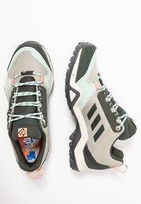 adidas Performance - TERREX AX3 BLUESIGN - Hiking shoes - fear grey/legend earth/grey tint - 1