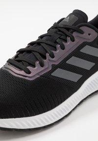 adidas Performance - SOLAR RIDE - Sports shoes - core black/night metallic/grey six - 5