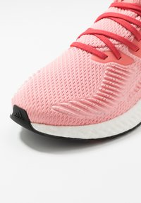 adidas Performance - ALPHABOOST - Neutral running shoes - glow pink/glow red/silver metallic - 5