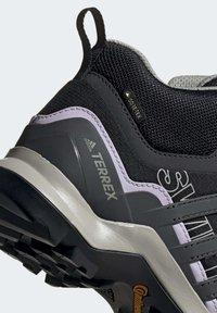 adidas Performance - TERREX SWIFT R2 MID GTX SHOES - Outdoorschoenen - black - 7