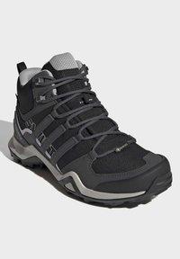 adidas Performance - TERREX SWIFT R2 MID GTX SHOES - Chaussures de marche - black - 3