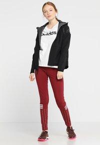 adidas Performance - LIN SLIM - T-shirts med print - white/black - 1