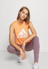 adidas Performance - MUST HAVES SPORT REGULAR FIT TANK TOP - Sportshirt - ambtin/white - 4