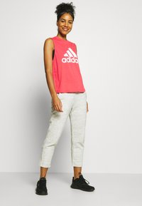 adidas Performance - MUST HAVES SPORT REGULAR FIT TANK TOP - Sports shirt - pink/white - 1