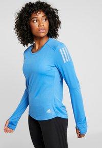 adidas Performance - OWN THE RUN - Camiseta de deporte - trublu - 0