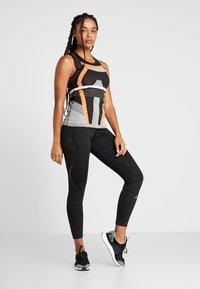 adidas Performance - PRIMEKNIT RUNNING TANK TOP - T-shirt de sport - black/chalk white/sesoor - 1
