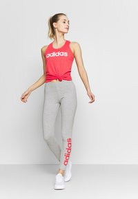 adidas Performance - SLIM - T-shirt z nadrukiem - pink/white - 1