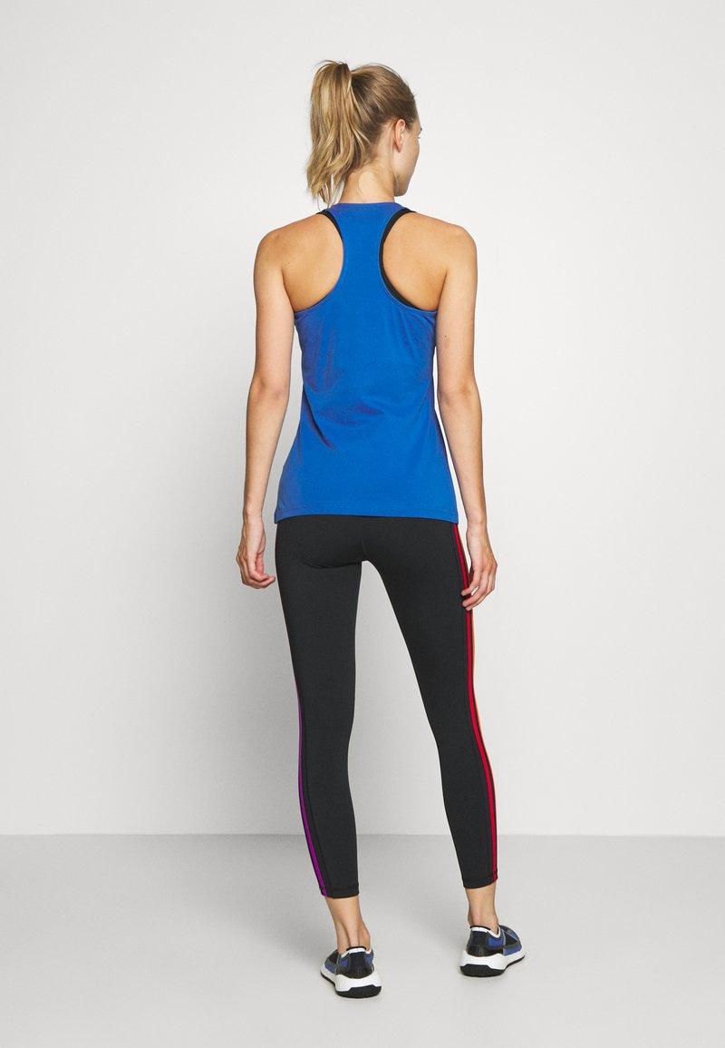 adidas Performance - SLIM - T-Shirt print - blue/white