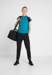 adidas Performance - LOOSE TANK - Funkční triko - active teal - 1