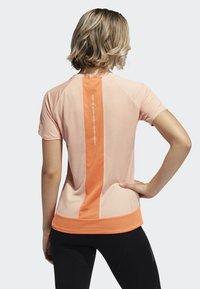 adidas Performance - 25/7 RISE UP N RUN PARLEY T-SHIRT - Sports shirt - pink - 1