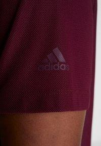adidas Performance - CROP TEE - T-shirt basic - maroon - 5