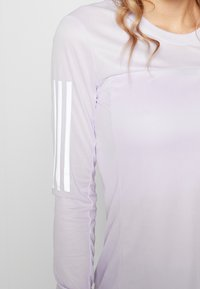 adidas Performance - OWN THE RUN AEROREADY LONG SLEEVE T-SHIRT - Sports shirt - purple - 5