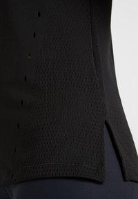 adidas Performance - ENGINEERED TEE - T-shirt z nadrukiem - black - 4