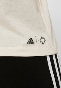 adidas Performance - GRAPHIC TANK - Sports shirt - off-white - 4