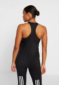 adidas Performance - TECH BOS TANK - Sports shirt - black/white - 2